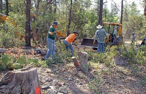 Courtesy<Br> Volunteer crews clear away tree branches and debris to make room for a new section of Trail No. 3 on the Prescott National Forest's Chino Valley Ranger District.