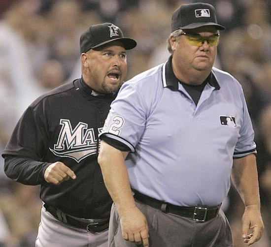 Lenny Ignelzi/<br>The Associated Press<br>Umpires like Joe West (above, right) and Laz Diaz (below, left) are used to getting chewed out by the likes of Major League managers. But will Instant Replay help or hinder the umps' efforts?