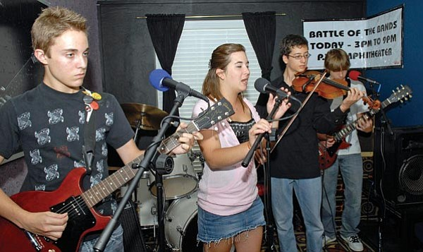 Jo. L. Keener/The Daily Courier<br> Musicians, from left, Jarod MacDonald-Evoy, Cate McCabe, Sky Jackson and Vincent Messenger practice at the Tri City School of Music Thursday evening.