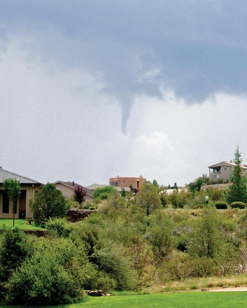 Trey Newton/Special to the Courier<p> Trey Newton shot this image from Prescott Lakes Golf & Country Club at about 11:10 a.m. Tuesday. He said the funnel cloud was over Glassford Hill Road in Prescott Valley.