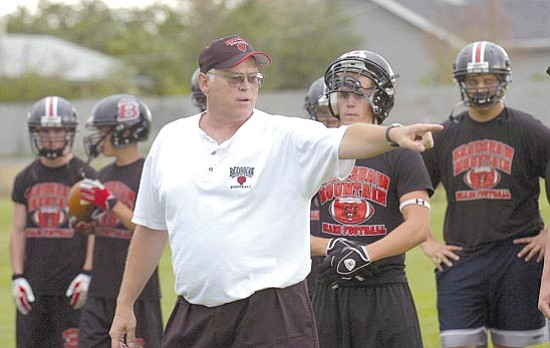 The Daily Courier/<br>Jo. L. Keener<br>Assistant Ron Fuson, seen in this July 30, 2007 file photo, who works primarily with linebackers on the defensive side of the ball, has been named interim head coach for Bradshaw Mountain.