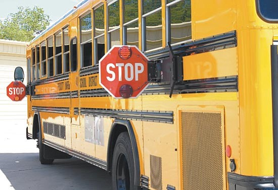Paula Rhoden/The Daily Courier<p> Area school buses return to city streets Aug. 4 as students return to school. Drivers should be cautious, watching for children at bus stops and buses stopped to pick up children.