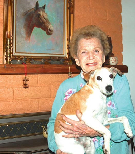 """Laura Flood/Courtesy photo<br> Marge Tucker of Chino Valley is a ranch woman. She's moved a herd, roped and doctored cattle and fed a doggie – a newborn, motherless calf – its first milk from a Coke bottle. Pictured with her is another """"doggie"""" of hers – Dewey."""