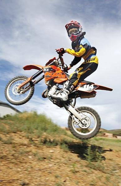 Les Stukenberg/The Daily Courier<br> Carter Griffin, a sixth-grade student at Bradshaw Mountain Middle School, catches some air on Thursday afternoon at a small track he built at his Dewey-Humboldt home.