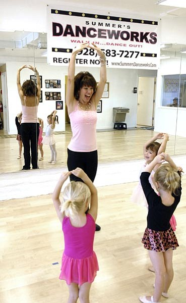 Jo. L. Keener/The Daily Courier<p> Summer Hinton works with young ladies during a dance class Tuesday morning at Danceworks in Prescott. The studio offers swing, tap, jazz and ballroom instruction.