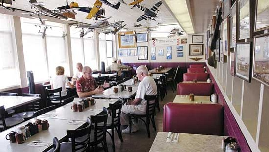 Jo. L. Keener/The Daily Courier<p> Patrons of the Skyway Restaurant drink coffee Friday morning.