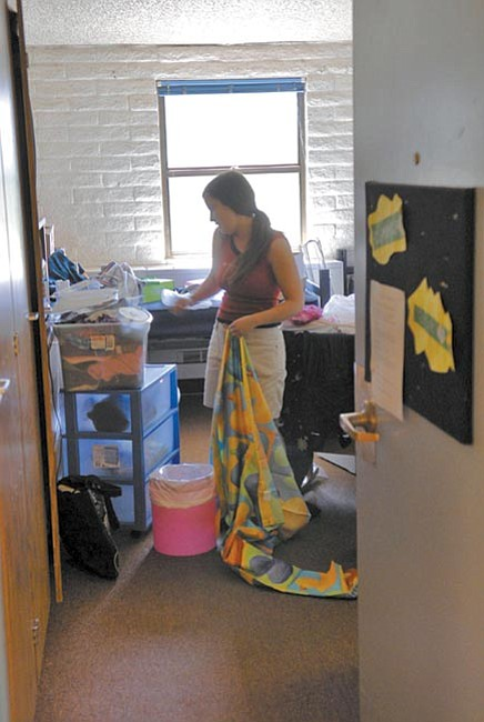 Jo. L. Keener/The Daily Courier<br> Stephanie Scarim of Cottonwood moves into her Marapai Hall dorm at Yavapai College Friday afternoon. Students will get used to sharing tight spaces and very little closet space.