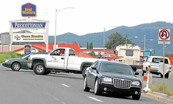 Matt Hinshaw/The Daily Courier<br> Unidentified drivers make illegal U-turns Friday afternoon on to the eastbound Highway 69 at the Highway 69 and 89 interchange in Prescott.