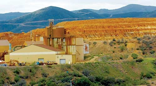 Jo. L. Keener/The Daily Courier<p> A large pile of tailings provides the backdrop for the old Iron King Mine in Dewey-Humboldt in this August 2007 file photo.