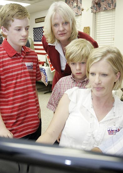 Les Stukenberg/The Daily Courier<p> Sydney Hay, center, looks at election result numbers with her daughter Sarah Raybon and grandsons Andrew and Caleb at her Prescott election headquarters.