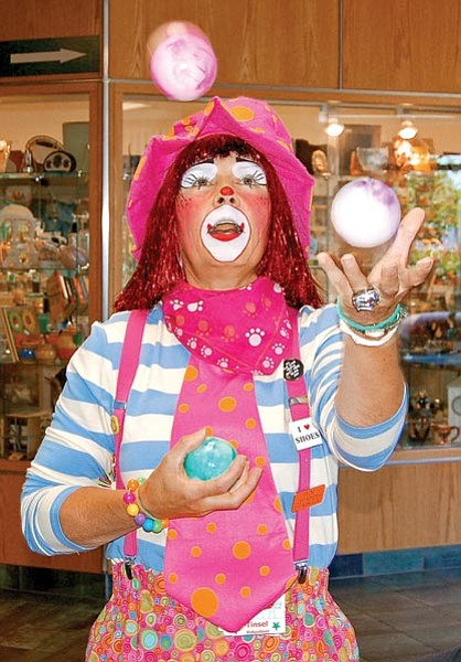 Paula Rhoden/The Daily Courier<br> Tinsel, a therapy clown for Yavapai Regional Medical Center, juggles Thursday afternoon at YRMC West in Prescott.