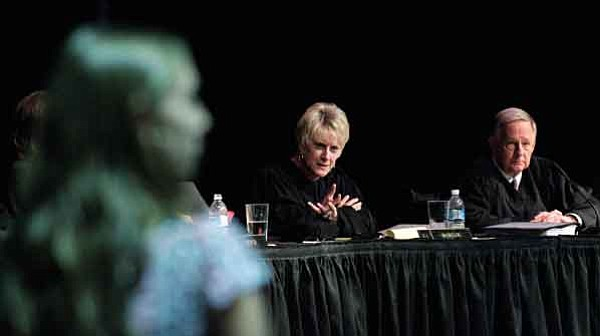 Les Stukenberg/The Daily Courier<br> Chief Justice Ruth McGregor and Justice Michael Ryan of the Arizona Supreme Court respond to questions Thursday during a session of the court at the Glassford Hill Middle School auditorium. The judges heard oral statements from  both sides on two cases and answered questions from the gathering of high school students from around Yavapai County.