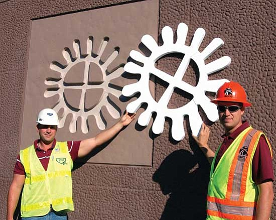Bruce Colbert/The Daily Courier<p> Tom Billings, project manager for FNF Construction, left, and Andy Roth, Arizona Department of Transportation resident engineer, display a Styrofoam block-out used to create a sun icon on the Highway 89-69 bridge project.