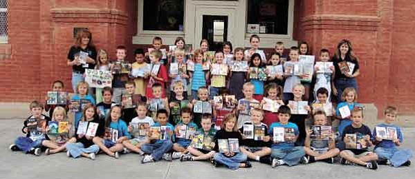 Paula Rhoden/The Daily Courier<br> The second graders at Lincoln Elementary School display some of about 200 DVDs they collected to send to U.S. Air Force Master Sgt. Kevin Perlak in Iraq.