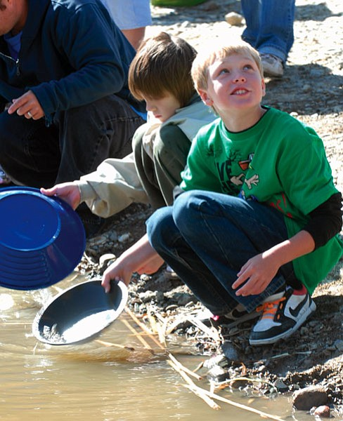 Gunner Miller and Chris Gosch try their hand at prospecting during the annual Prescott Valley Gold Fever Days event. The event highlighted the gold that prospectors have found in the past century in Lynx Creek, which feeds Fain Lake in Prescott Valley. (Tribune, file)