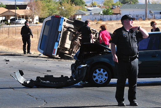 Prescott Valley Police and Central Yavapai Fire respond to a two-vehicle collision at the intersection of Lakeshore Drive and Windsong Drive Monday afternoon.  Les Stukenberg/The Daily Courier