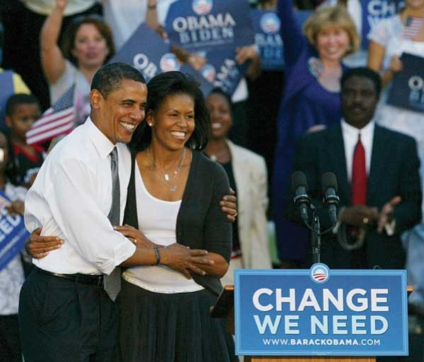 Wilfredo Lee/The Associated Press<p> Barack Obama and his wife Michelle hold each other during a rally in Miami Oct. 21.
