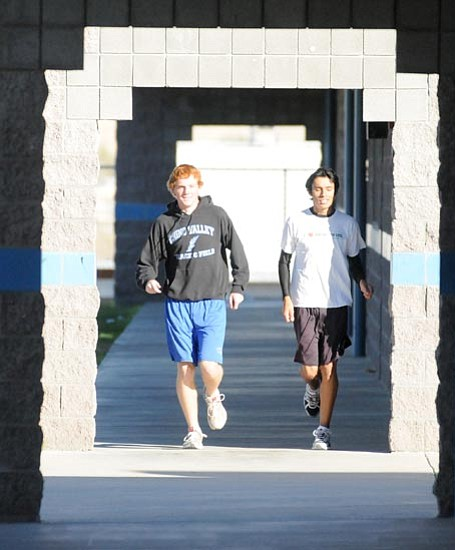 Les Stukenberg/<br>The Daily Courier<br>Larry Hermance, left, and Juan Martinez paced the Cougar team Saturday at state. Hermance captured sixth place and, for a second straight year, Martinez took fifth place at the 3A final meet.