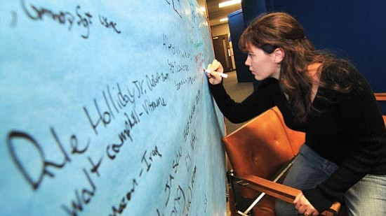 Les Stukenberg/The Daily Courier Rachel Cushman, a senior at  Prescott High School, adds an 8th name of her relatives that have served in the armed forces to the Veterans Wall at the school on Monday.