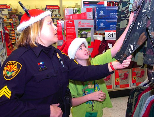 File photo/The Daily Courier<br> Prescott Sgt. Amy Bonney, left, helps Brittany Whitlock with shopping during the 2006 Shop with a Cop program, the annual shopping excursion that pairs children and police officers.