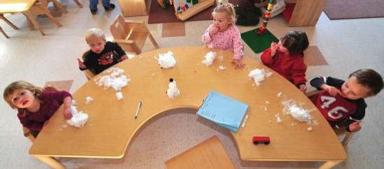 Les Stukenberg/The Daily Courier<p> Children enrolled at the Yavapai College Family Enrichment Center enjoy playing and learning with some snow that one of the parents brought in on Monday.