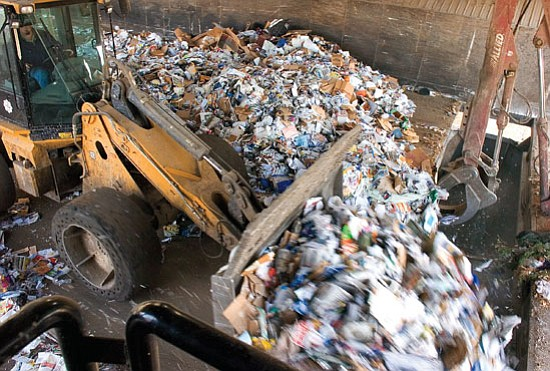 Matt Hinshaw/The Daily Courier <br> Bill Belevins a Senior Equipment Operator pushes a load of recyclables into a waiting semi truck Wednesday evening at the City of Prescott Solid Waste Transfer Station.  The City of Prescott Solid Waste Transfer Station recycles 300 tons of materials each year.