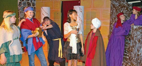 "Cheryl Hartz/The Prescott Valley Tribune<P> From left are Mercedes Ogden (Aladdin's mother), Amelia Harris (Aladdin), Joe Aldridge (a wicked stranger), Darcie Hill (Princess Jasmine), Henry Villani (Sultan), Trinity Divelbiss (lamp genie) and Isabelle Jensen (ring genie) in the Lonesome Valley Playhouse non-musical production of ""Aladdin."""