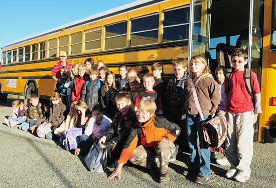 Students on Fred Pamer's bus going to Humboldt Elementary School raised money to help feed two families over the Thanksgiving holiday. (Les Stukenberg/Courier)
