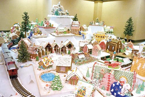 Gingerbread houses sit on display at the Prescott Resort and Conference Center Wednesday afternoon in Prescott.  The annual Gingerbread Village display consists of over 100 houses and is a fundraiser for the Yavapai Big Brothers Big Sisters.  Matt Hinshaw/The Daily Courier