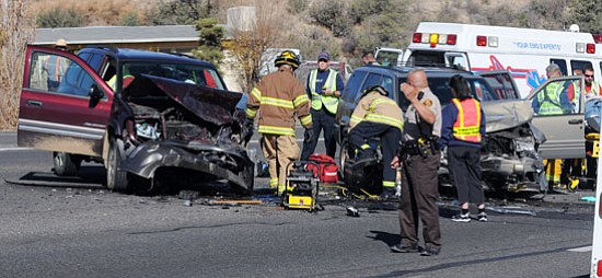 Les Stukenberg/The Daily Courier<br> Emergency workers direct traffic and treat the injured in this two-vehicle collision on Highway 69 and Emerald Drive in Prescott Valley late Wednesday morning.