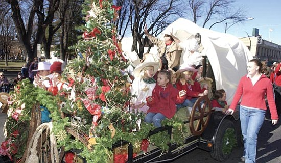 The Daily Courier<p> A float from last year's Prescott Downtown Christmas Parade highlighted the town's history with its covered-wagon design.