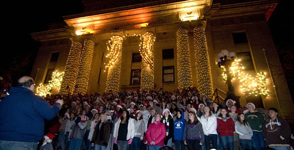 Les Stukenberg/The Daily Courier<br> Students from school choirs across Yavapai County gather on the courthouse steps and sing during the annual Courthouse Lighting program Saturday night in downtown Prescott. The lights will be on display through the holidays.
