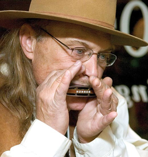 Matt Hinshaw/The Daily Courier<p> Lee Timmons plays his harmonica while performing with Robert Karney during the 20th Annual J.S. Acker Musical Showcase in downtown Prescott Friday night.