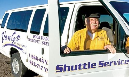 Matt Hinshaw/The Daily Courier<p> Larry Dreyer with the Van Go Shuttle Service stands next to his van Wednesday morning in Prescott Valley. Dreyer recently hit one million miles in his van shuttling passengers to Phoenix.