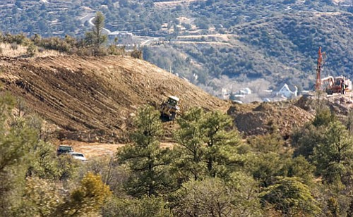 Matt Hinshaw/The Daily Courier<br> Contractors clear an area where the Yavapai-Prescott Indian Tribe plans new housing on its reservation next to Prescott.