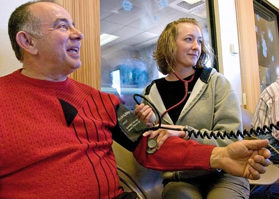 "Matt Hinshaw/<br>The Daily Courier<br>Sheila Brawn, an exercise Physiologist at Del E Webb Outpatient Center, takes Chuck Apap's blood pressure on Friday. ""He's been very dedicated and very motivated to make the lifestyle changes that he's needed to,"" she said."