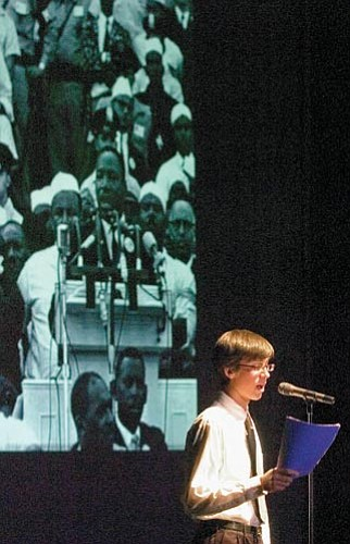 """Matt Hinshaw/The Daily Courier Isaac Benson-White reads Martin Luther King Jr.'s """"I Have a Dream Speech"""" Friday night during Prescott High School Fine Arts Department Presents Believe, a tribute to Martin Luther King Jr."""