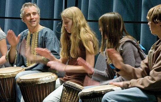 """Matt Hinshaw/The Daily Courier<p> Members of the Mountain Oak Charter School Drum Group, led by Dave Sorenson, perform for the crowd during Yavapai College's """"The Bridge to Unity: An Evening of Musical Performances and Presentations Commemorating the Wisdom of Dr. Martin Luther King Jr."""" Monday night at the Yavapai College Performance Hall in Prescott."""