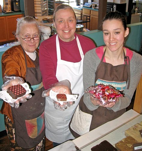Jason Soifer/The Daily Courier<p> Co-owners Mary Handley and her daughter Irene Handley, along Irene's daughter Ashley Moser, stand with some delectable sweets at Pralines of Prescott Wednesday afternoon.  The store is in the Bashford Courts shopping center.