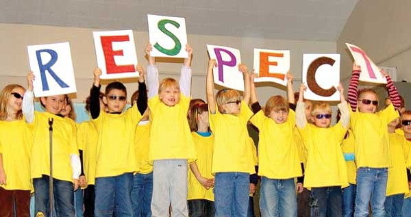 Paula Rhoden/The Daily Courier<br> First-grader at Lincoln Elementary School sing along with Aretha Franklin's R-E-S-P-E-C-T during the school Character Counts assembly Jan. 23. Respect is one of the six pillars of Character Counts.