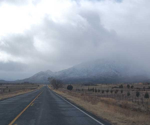Tim Wiederaenders/The Daily Courier<br> Storm clouds bear down on Granite Mountain and Williamson Valley on Saturday.