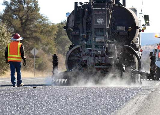 The Daily Courier<p> Yavapai County Public Works road crews chip-seal a portion of Williamson Valley Road. County budget cuts reduced the number of roads in the chip-seal program.
