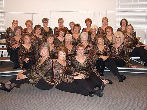 Courtesy photo<br> Suzy Lobaugh, front, center, poses with the Songs of the Pines singers in a 2008 group photo.