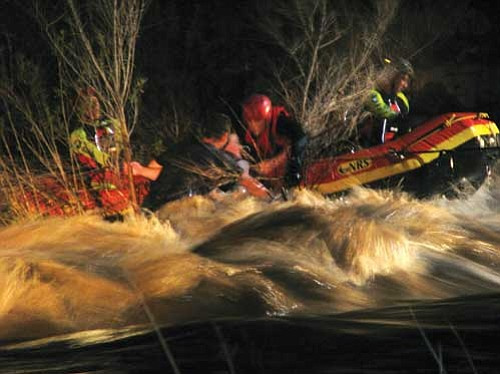 Kala Pearson/Courtesy photo<br> Rescuers using ropes and a raft were able to bring ashore a 29-year-old man and a 32-year-old woman out of a swollen creek.