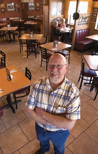 Matt Hinshaw/The Daily Courier<p> Daryl Davis, co-owner of Leff-T's Steakhouse and Grill in Dewey, has been in the restaurant business for 40 years.
