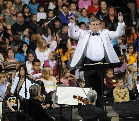 Les Stukenberg/The Daily Courier<p> Paul Manz conducts the orchestra as almost 4,400 students attend the 2nd Annual Music Memory Concert hosted by the Yavapai Symphony Guild at Tim's Toyota Center in Prescott Valley.