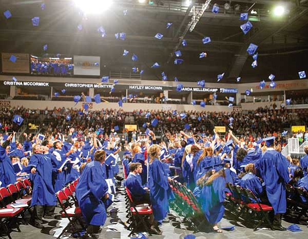 The Daily Courier/Matt Hinshaw<p> Prescott High School seniors celebrate at Tim's Toyota Center May 23, 2008, during the Class of 2008 Commencement Ceremony in Prescott Valley. A plan to hold graduation at Tim's in 2009 has caused an uproar with students and parents.