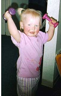 This is an older picture of my Niece, JK Stephenson. She loves to play in my weight room when ever she comes to visit.