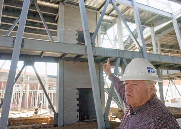 Matt Hinshaw/The Daily Courier<br> Dan Hurley, site superintendent for Barton Malow Design and Construction Services, shows where the observation deck will be at the construction site of the new Prescott Valley Library Friday afternoon.