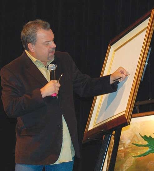 Bruce Colbert/The Daily Courier<br> World-famous artist Thomas Kinkade sketches a drawing during his visit Sunday to Prescott. More than 500 fans attended the free event at the Elk's Opera House. Kinkade auctioned the sketch for $12,000 to benefit Make-a-Wish and Big Brothers/Big Sisters.